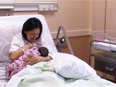 Stock Video Footage of mother nursing newborn