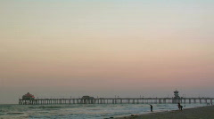 Huntington Beach Pier wide dusk Stock Footage