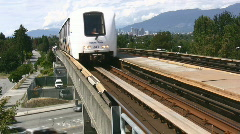 Vancouver Rapid Transit Train Approaches A Suburban Station Stock Footage