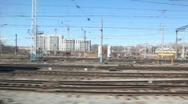 Trains and railroad tracks with city on background from moving train Stock Footage