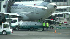 Into the plane load luggage Stock Footage