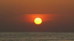 Sunset, the sun sits down the sea - stock footage
