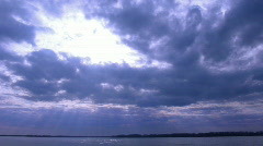 Dark Clouds over water Stock Footage