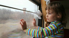 Stock Video Footage of girl looking through window on  moving train