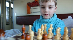 Boy, playing chess on a train Stock Footage