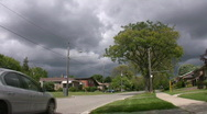 Stock Video Footage of Stormclouds in suburbia.