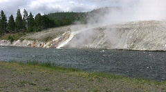 Hot Springs flowing into river at Yellowstone Park Stock Footage