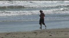 South Padre beach girl walking pan shot Stock Footage