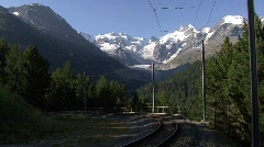 Train in Front Of Bernina Glacier  - stock footage