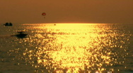 Watersports at sunset 1 Stock Footage