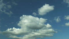 Time lapse puffy white clouds Stock Footage