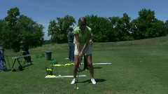 vid058 woman and friends golfing at range - stock footage