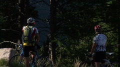 Mountainbikers in Front Of Glacier Stock Footage