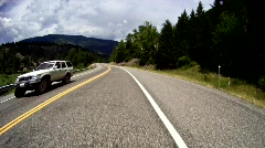 Driving along mountain road Stock Footage