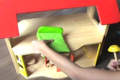 Girl Playing With Furniture In Doll House Stock Footage