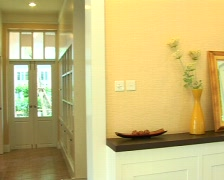 Pan from entrance to decor in room - stock footage