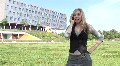 HD1080i Young blond woman outdoors talking on cell phone Footage