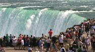 Tourists at Niagara Falls edge Stock Footage