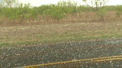 Large hail falling on road, golf ball sized hailstones Stock Footage