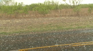 Stock Video Footage of Large hail falling on road, golf ball sized hailstones