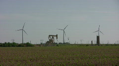 Wind mill farm and oil well pumping 2 Stock Footage