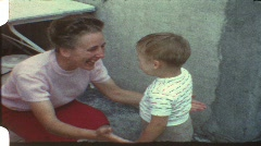 Mother hugs toddler (vintage 8 mm amateur film from the 1960s) - stock footage