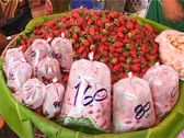 Strawberries for sale at Thai market Stock Footage