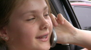 Young woman talking on mobile phone in car Stock Footage