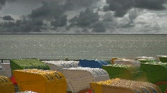 Beach chairs against stormy sky Stock Footage