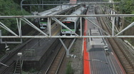Stock Video Footage of Multiple commuter trains passing in Tokyo