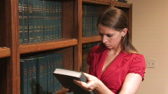 Stock Video Footage of Female Lawyer Retrieving Book