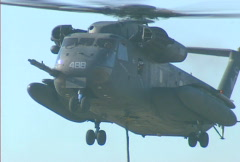 Helicopter flies off 01 Stock Footage