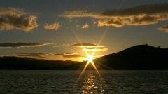 Orange sunset over a lake 2 - stock footage