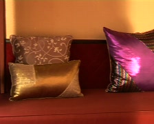 Decorative Thai Silk Pillows On A Red Sofa Stock Footage