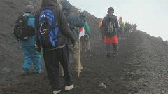 Hikers descending Mount Fuji - stock footage