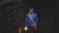Children explore secrect tunnel Stock Footage