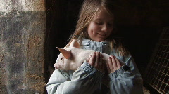 Girl holds piglet - stock footage