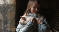 Girl holds piglet Stock Footage
