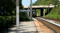 Train approaching railway station Stock Footage