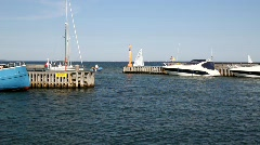 Sailboat approaching harbour Stock Footage