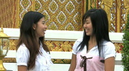 Stock Video Footage of Asia Girls Talking-Cell Phone Interruption