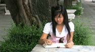 Two Asian Girls Doing Schoolwork Stock Footage