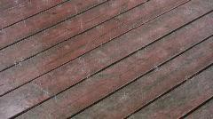 Rain on wood deck. Stock Footage