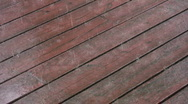 Rain on wood deck. Stock Footage