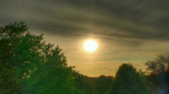 Sunset over trees hdr time lapse Stock Footage