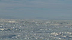 Pan across arctic tundra, snow and ice field. - stock footage