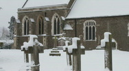 Stock Video Footage of English church deep in snow, picture postcard scene