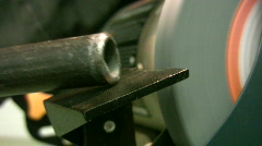 vid054 bench grinding on steel pipe - stock footage