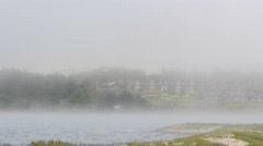 Fog rolls by the coastline at Bodega Bay Stock Footage