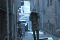 Homeless Drunk Bum Walks Down a Cold Wet Alley  Stock Footage
